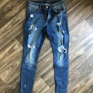 Mid Rise Skinny Distressed Ripped Jeans